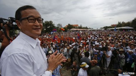 Sam Rainsy, leader of the Cambodia National Rescue Party (CNRP), smiles as he meets his supporters during the day of a three-day protest at Freedom Park in Phnom Penh, 17 September 2013