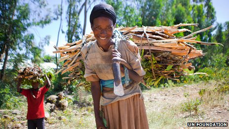 A woman in Ethiopia hauls firewood