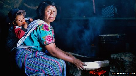 Woman with baby cooks in Guatemala