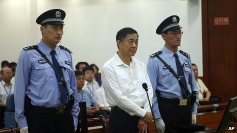 In this 22 August 2013 file photo released by the Jinan Intermediate People's Court, former Politburo member and Chongqing city party leader Bo Xilai, centre, stands on trial at the court in eastern China's Shandong province