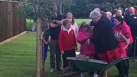 Mrs Swain planting one of the trees