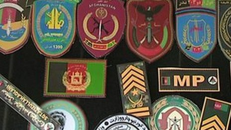 Military insignia for sale on the black market in Kabul