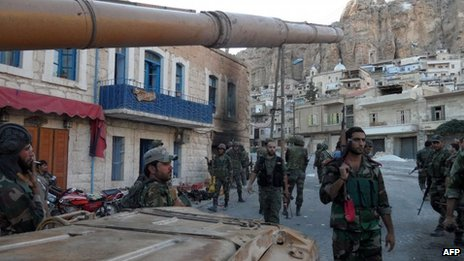 Syrian pro-government troops are seen on the streets of the Christian town of Maaloula