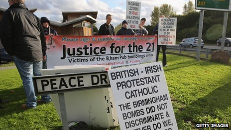 Protestors outside the Tim Parry-Johnathan Ball Foundation for Peace in Warrington