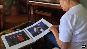 Patricia Arnold, of Rochester, Michigan looks at family photos, that include her son Michael Arnold on 17 September 2013