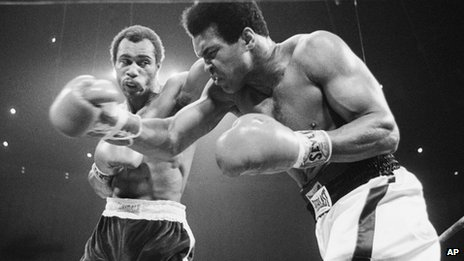 Muhammad Ali, right, winces as Ken Norton hits him with a left to the head during their re-match at the Forum in Inglewood, California 10 September 1973