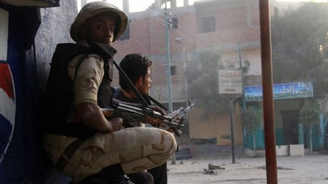 Egyptian security forces take cover