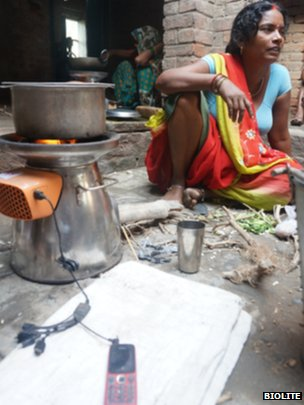 A woman in India charges her phone and cooks on a BioLite stove