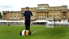a groundsman at Wembley Stadium, marks out the the lines of a football pitch in the gardens of Buckingham Palace