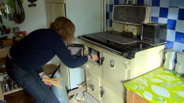 A woman lighting a cooker