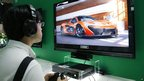 A visitor tries Microsoft Xbox One