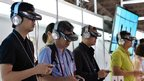 Visitors wear Japanese electronics giant Sony's new head mount display