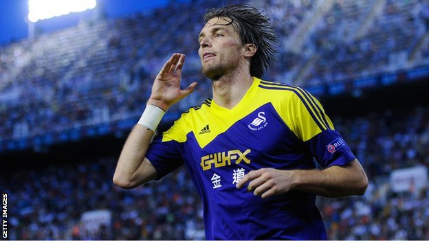 Michu celebrates his goal