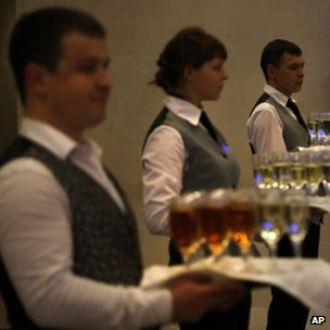 Waiters hold trays of drinks ready for a reception at the Valdai forum. Photo: 19 September 2013