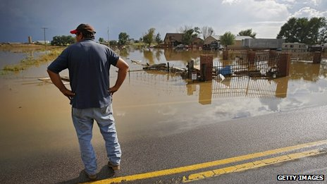 Manuel Sanchez takes in the view of his flooded home and property on in La Salle, Colorado, on 14 September 2013
