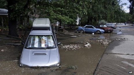 Vehicles damages by flood waters on a street in Lyons, Colorado, on 13 September 2013