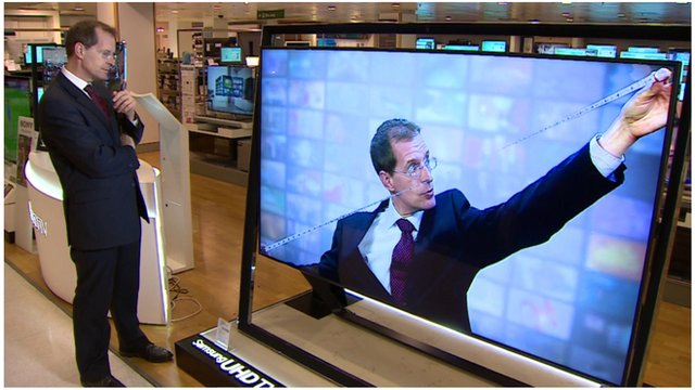 BBC's David Sillito watches his own report on a big TV screen
