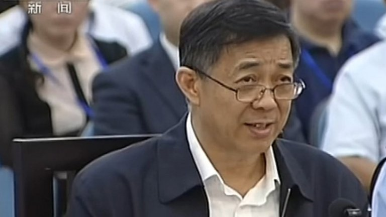This screen grab taken from state television CCTV footage broadcast on 25 August 2013 shows ousted Chinese political star Bo Xilai speaking in the courtroom as he stands trial at the Intermediate People's Court in Jinan, in eastern China's Shandong province