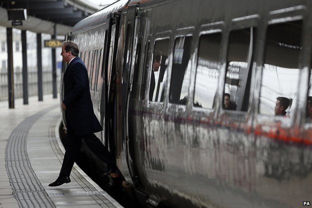 David Cameron alighting from a train