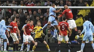 Vincent Kompany rises to head in