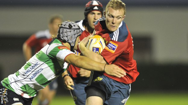 Munster wing Keith Earls is tackled in the defeat by Treviso