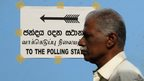 Tamil man arrives to vote at a polling station