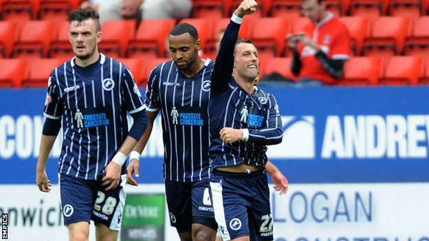 Scott McDonald celebrates putting Millwall ahead against Charlton