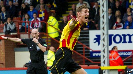 Aaron Muirhead celebrates his penalty against Kilmarnock