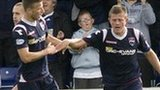 Melvin De Leeuw (left) congratulates winning Ross County goalscorer Richard Brittain