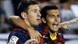 Pedro Rodriguez (right) of FC Barcelona celebrates with his team-mate Lionel Messi