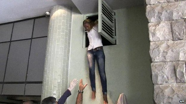 Woman jumps down from air vent in the Westgate shopping centre, Nairobi (21 September)