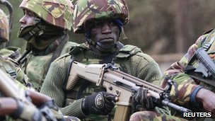 A soldier from the Kenya Defence Forces (KDF) holds his gun as he arrives at the Westgate Shopping Centre in the capital Nairobi 22 September, 2013.