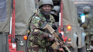 Members of Kenya Defence Forces (KDF) arrive at the Westgate centre on 22 September, 2013.