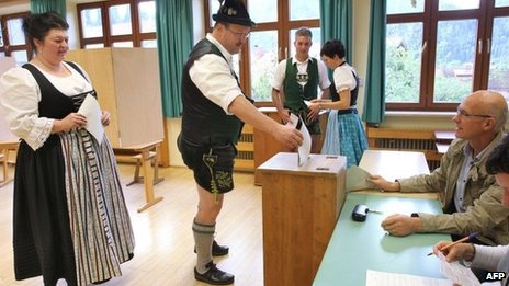 Germans wearing traditional clothes vote in in Bad Hindelang, Bavaria, 23 September