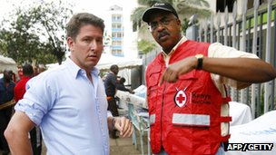 Christian Turner, British High Commissioner to Kenya, (left) chats with Kenya's Red Cross Secretary General Abbas Gullet after giving blood