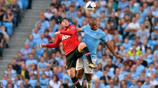 Wayne Rooney and Vincent Kompany