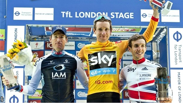 Sir Bradley Wiggins savours his Tour of Britain triumph with second placed Martin Elmiger (left) and Britain's Simon Yates (right) who was third