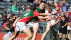 David Kenny and Diarmuid O'Connor of Mayo  close in on Tyrone half-back Padraig McGirr