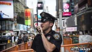 A US police officer speaks into his radio in Times Square, New York