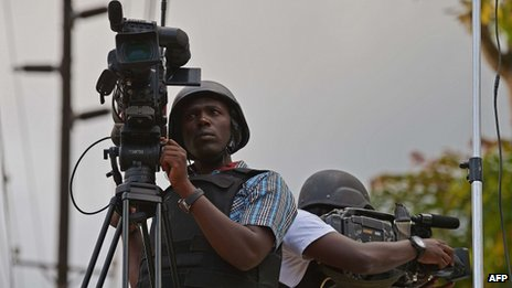 Kenyan media wearing bullet proof jackets and helmets near the Westgate mall in Nairobi on 22 September 2013