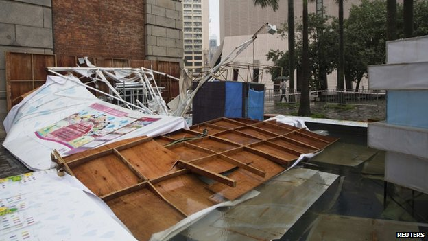 An advertisement board which was toppled over by Typhoon Usagi is pictured in Hong Kong, 23 September 2013