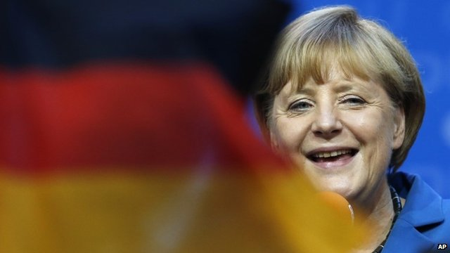 Angela Merkel and German flag