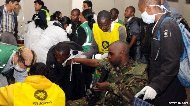 An injured Kenyan soldier receives treatment at Oshwal center in Nairobi