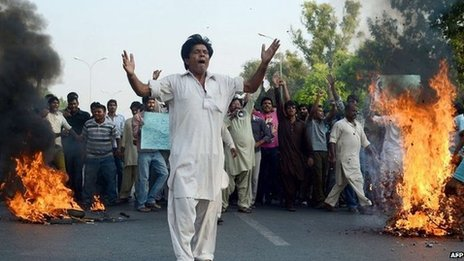 Pakistani Christians gather in a protest in Islamabad on September 22, 2013, against the killing of their community members in two suicide bomb attacks on a Church in Peshawar. A