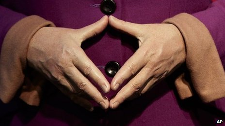 The hands of Angela Merkel, on her waxwork dummy at Germany's Madame Tussauds