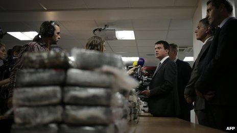 Manuel Valls speaks at a news conference on 21 September, 2013