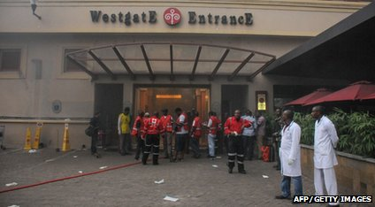 Medics wait outside a shopping centre