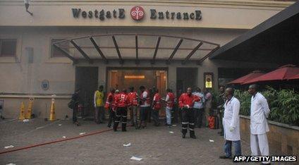 Medics wait outside a shopping centre