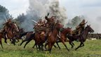 A cavalry charge during a reconstruction of the Battle of the Bzura