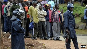 Kenyan police keep onlookers back as they wait for news outside the Westgate centre